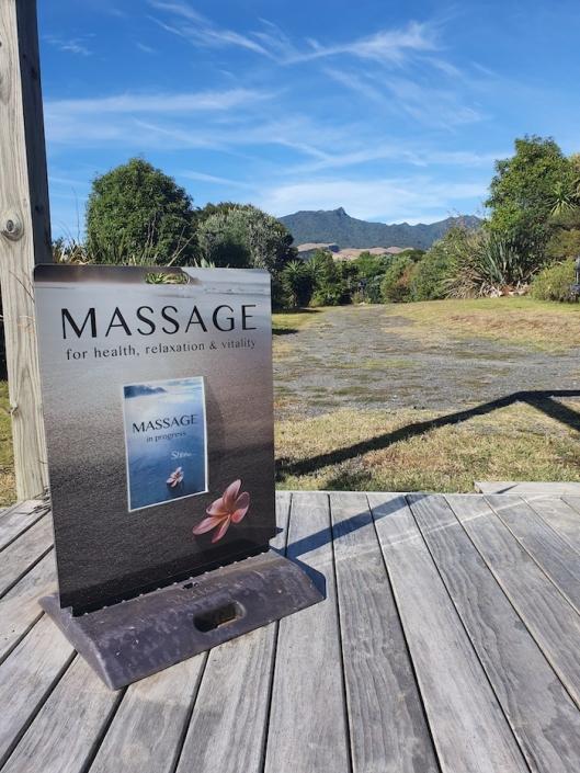 Raglan Seaside Massage sign and Mount Karioi