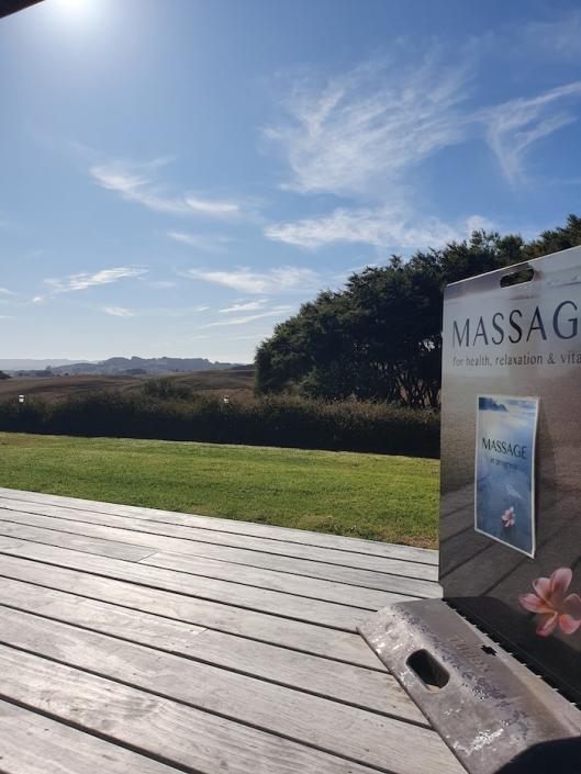 Raglan Seaside Massage sign & rolling green hills